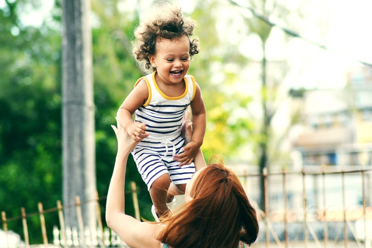 selective focus photo of woman lifting child during daytime - 6 Ways to Make Sure that You Offer Great Customer Support at Your Preschool