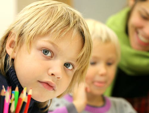 boy child childhood class USA Get responses that matter - The 2 Main Steps of Using a Survey to Start Your Preschool